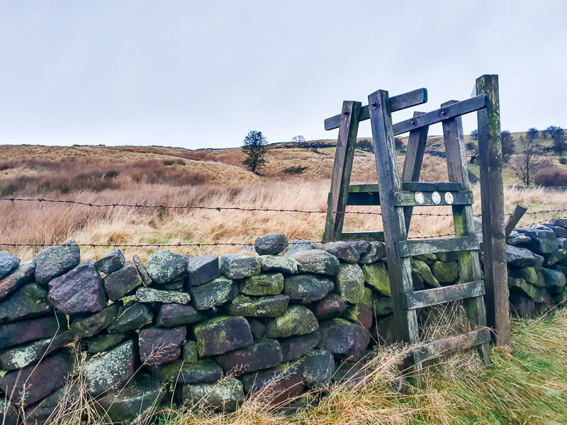 Over the tall wooden stile near the end of the walk
