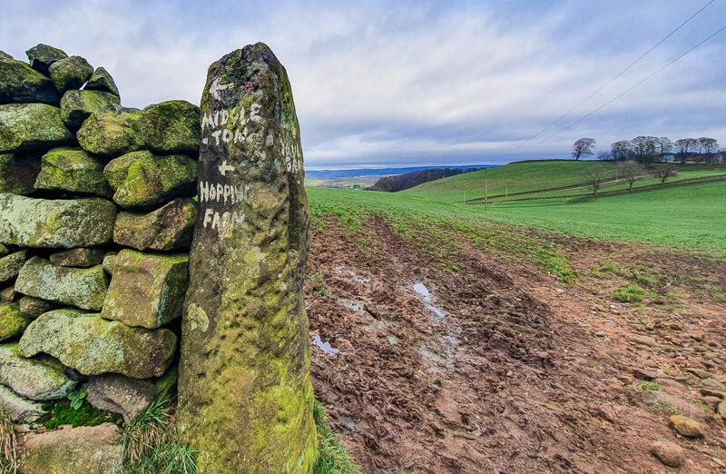 Stone pillar with wording