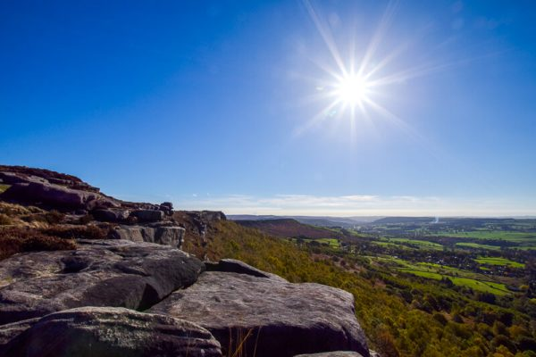 Rocks and blue skies, with bright sun