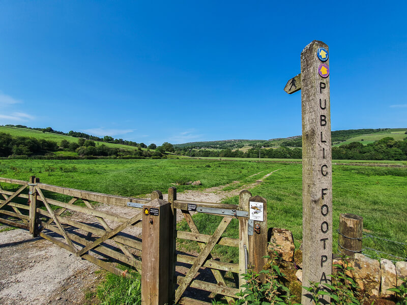 Signpost and gate into field