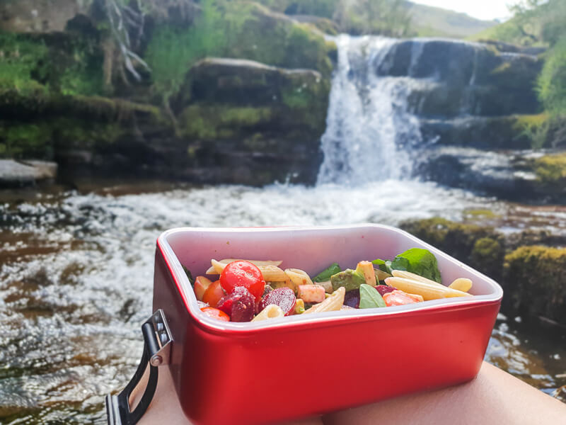 Lunchbox next to waterfall