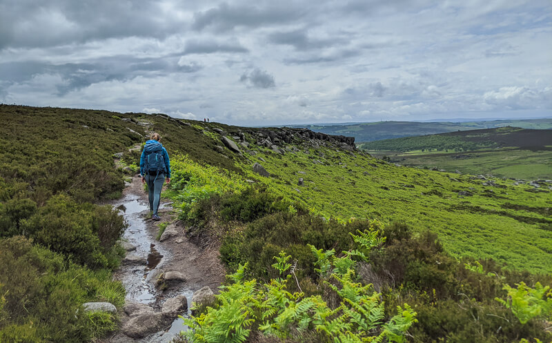 Person walking along Burbage Edge