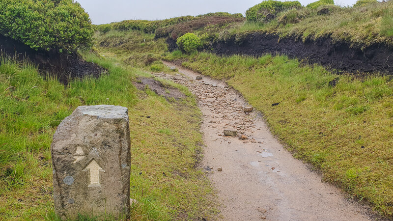 Stone sign on Pennine Way path