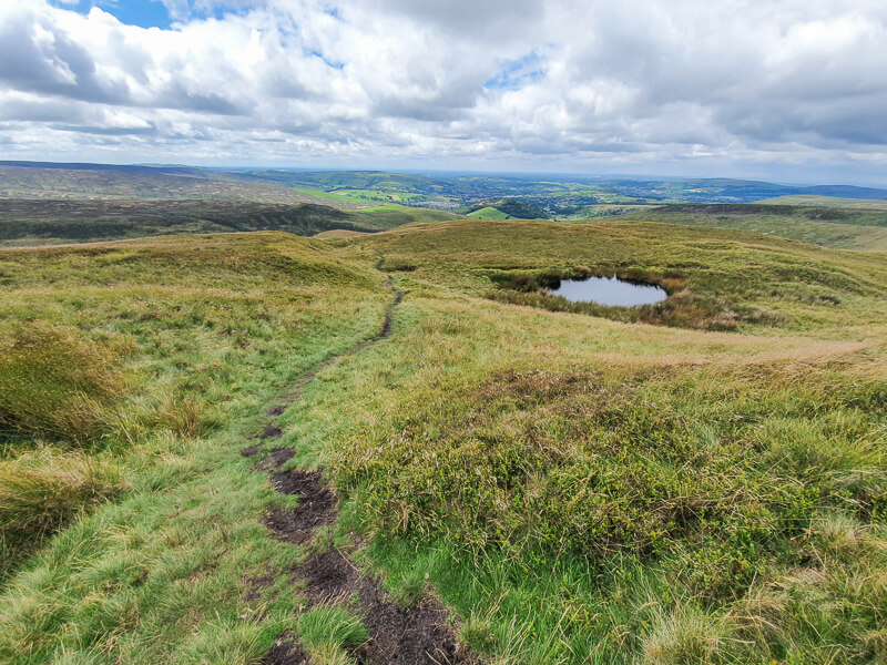 Narrow path and small tarn