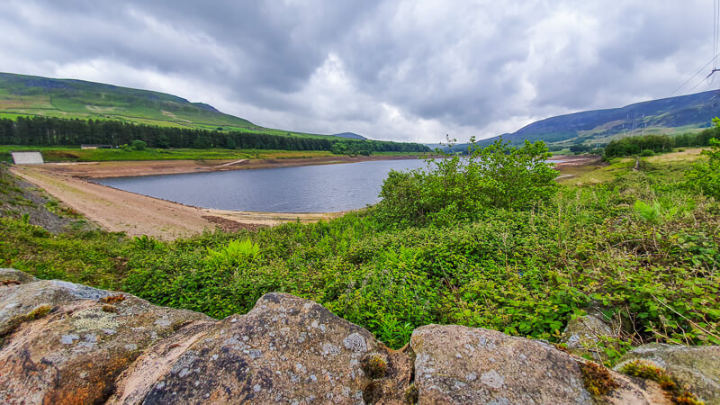 Torside Reservoir over stone wall