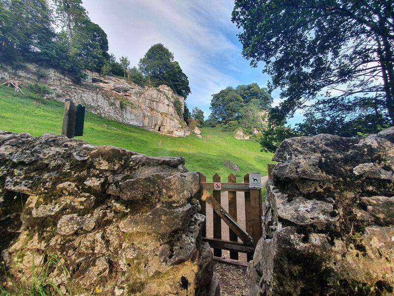 Gate and drystone wall start of Wolfscote Dale