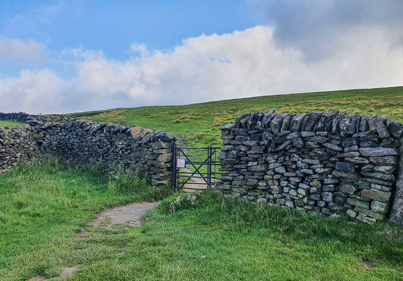 Footpath, gate and drystone wall