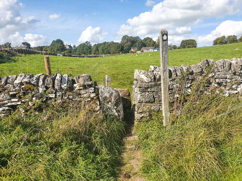 Drystone wall with signpost