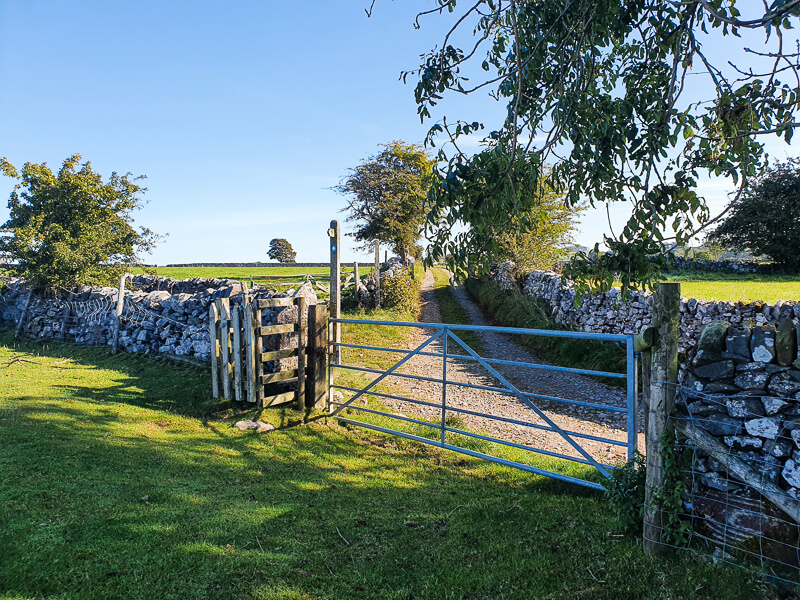 Gate and signpost