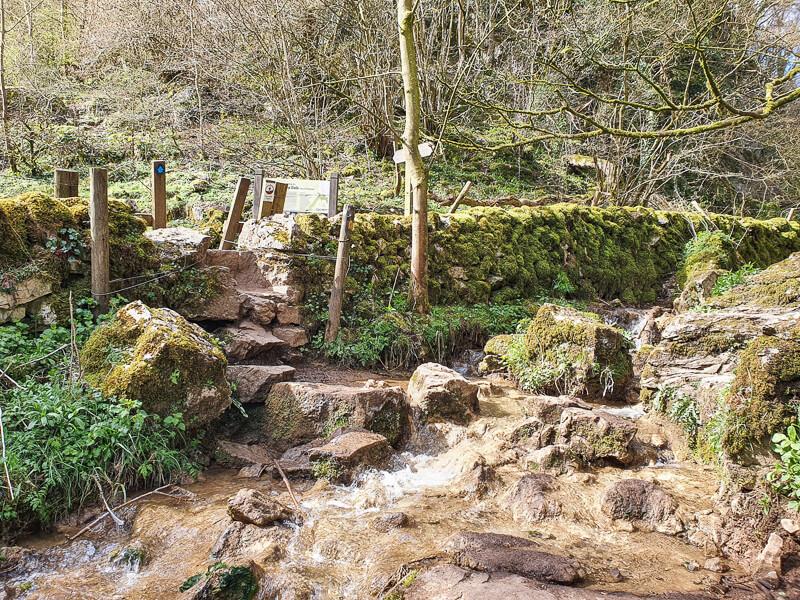 Stone stile and rocky stream