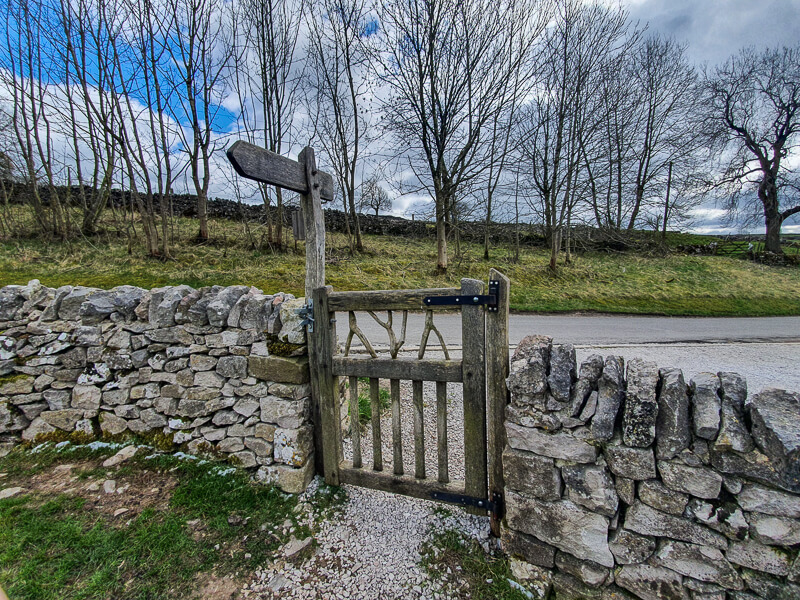 Gate and stone wall