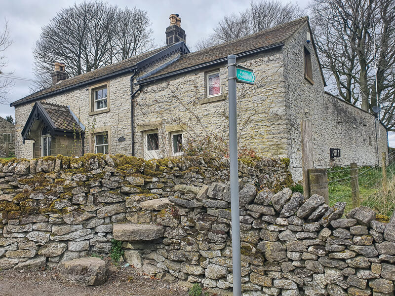 Stone wall and house