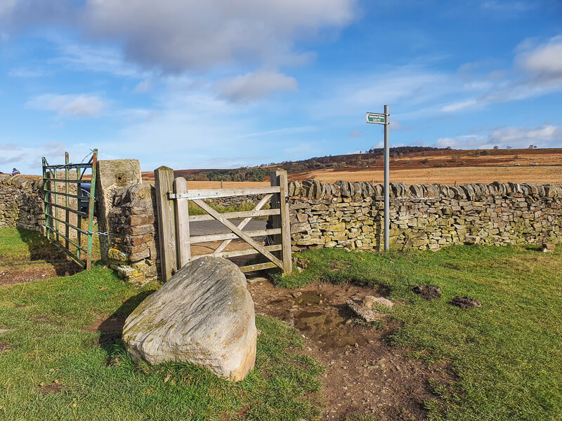 Big boulder, gate and stone wall