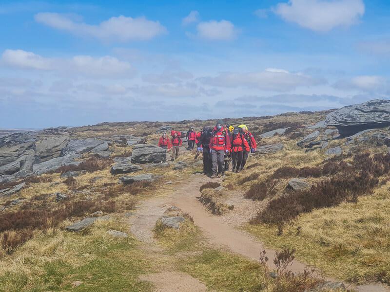 Blue skies, Mountain rescue team walking