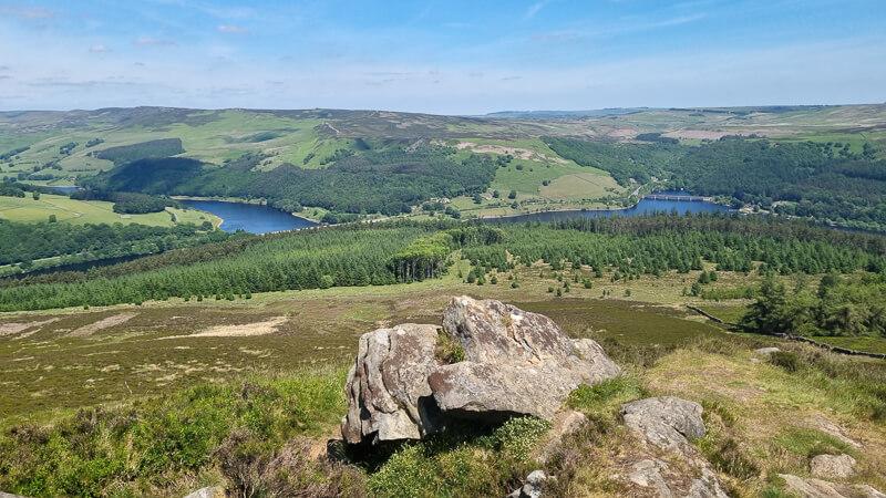 Ladybower Reservoirs from Win Hill summit, rocky outcrop and green hills