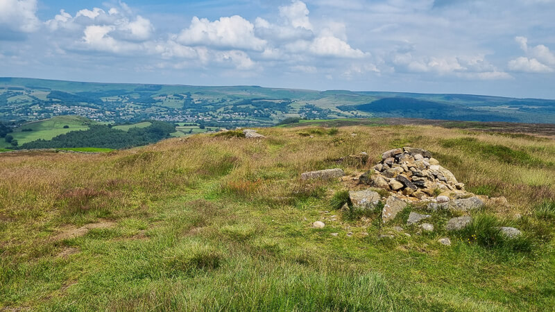 Stone cairn and grass on Eyam Moor